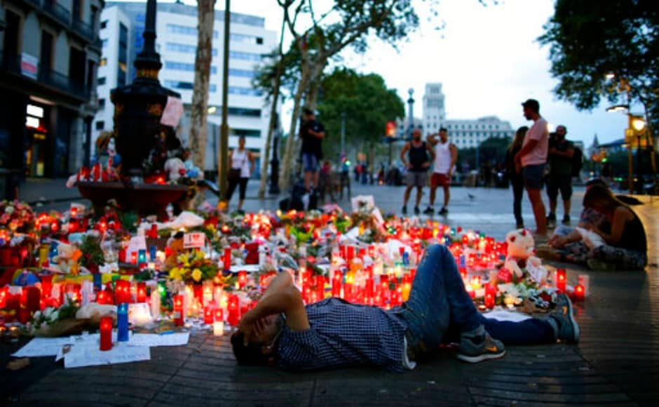 King Felipe of Spain joined people in Barcelona for a minute's silence on Friday where defiant crowds chanted