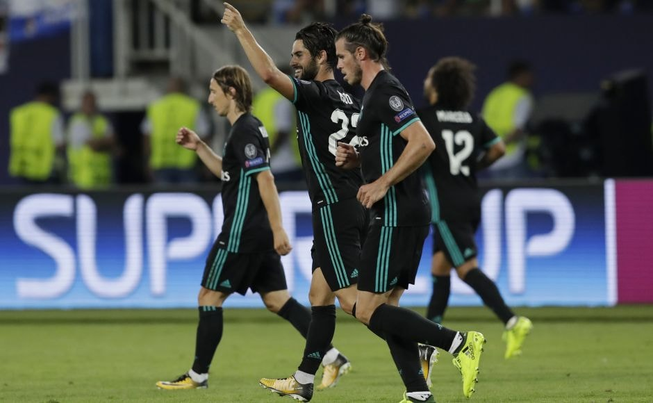 Isco (centre), extended the lead for Real Madrid with a shot in the 52nd, after Gareth Bale helped him run through United's defense. AP