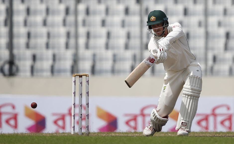 Pat Cummins and Ashton Agar stalled Bangladesh's progress to steer Australia to 193-8 at tea, combining 49 off 143. However, in the first over after tea, Shakib got Cummins to end the stubborn partnership. Cummins scored 25 off 95 with one four and one six. AP