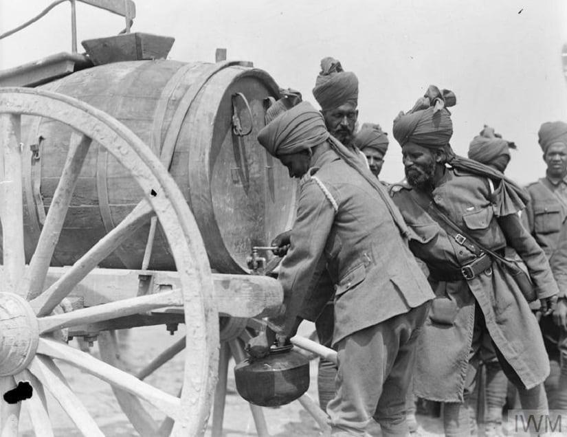 Indian gunners filling water canteens near Pas, in Flanders, June 1918. Photo credit: Imperial War Museum