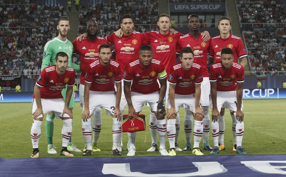 Manchester United players pose for a photo at the start of the UEFA Super Cup final. The Super Cup pitches the previous season's Champions League winners (Real Madrid) against the Europa League holders (Manchester United). AP