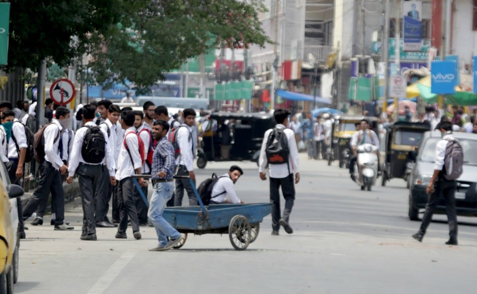 For the first time in recent history, such a large proportion of Kashmir's student community initiated protests following the killing of a foreign militant (Dujana). Firstpost/Suhail Bhat