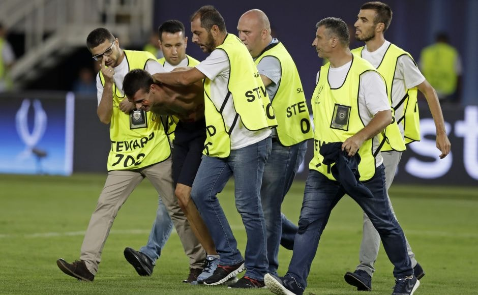 Moments before the final whistle, a shirtless fan ran onto the pitch and was wrestled to the ground by stewards. AP