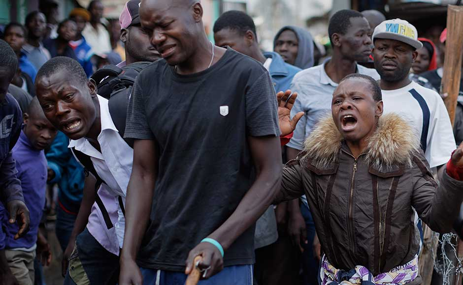 Clashes with protesters left two people dead in Nairobi's Mathare slum. The capital's police chief said officers opened fire after they were attacked by men wielding machetes. In the southeastern Tana river region, police killed two people after a group of five stormed a vote-tallying centre and stabbed one person. AP