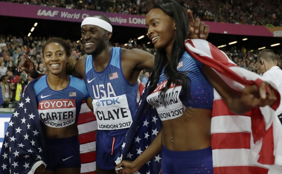 American triple jump silver medal winner Will Claye (centre) celebrates with women's 400m hurdles gold medal winner Kori Carter (L) and silver medal winner Dalilah Muhammad (R). AP