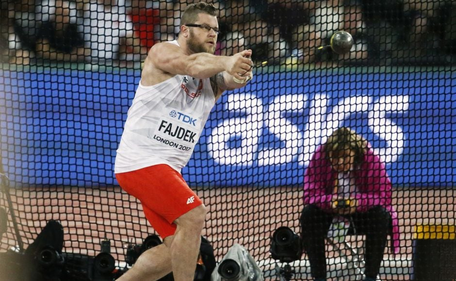 Poland's Pawel Fajdek won his third straight hammer throw world title with a throw of 79.81 metres. AP