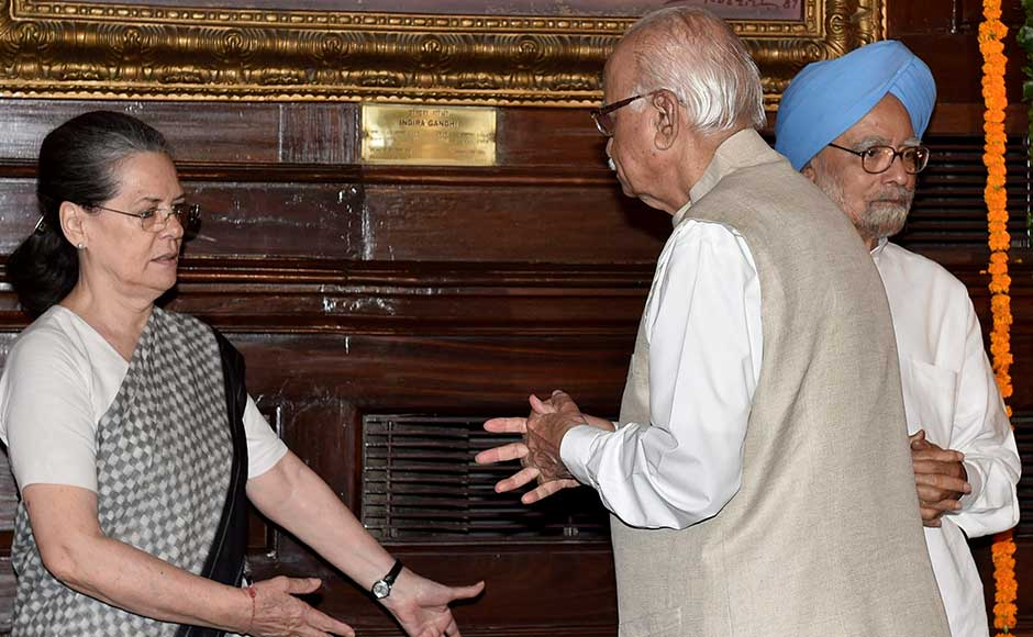 Former prime minister Manmohan Singh looks on while Sonia Gandhi interacts with senior BJP leader LK Advani, who paid his tributes to Rajiv Gandhi on his birth anniversary at Parliament House in New Delhi on Sunday. PTI