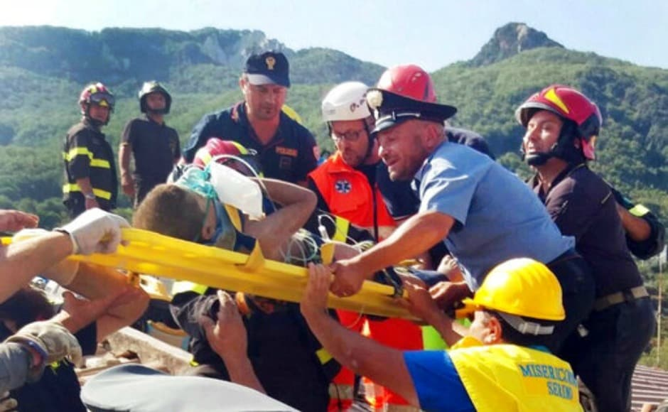 Firefighters and rescuers pull out a boy, Mattias, from the collapsed building in Casamicciola, the epicenter of a 1883 earthquake that killed more than 2,000 people. AP