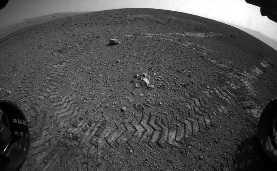 Tracks made by the wheels of the rover, one of the earliest images Curiosity beamed back. Image: NASA.