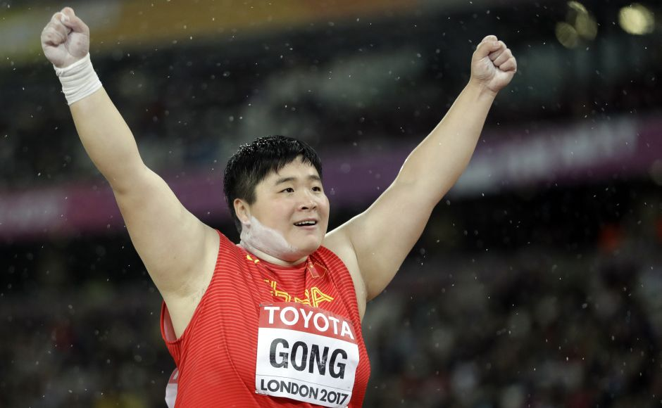 China's Gong Lijiao celebrates after winning the gold medal in the women's shot put final at the IAAF World Championships. AP