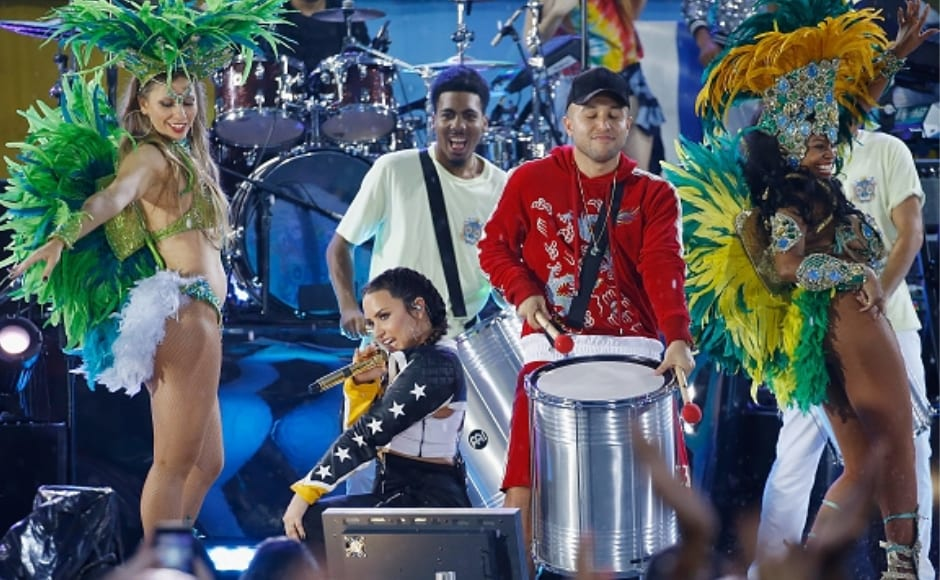The concert was a colourful affair, with Lovato and her back-up dancers in exotic costumes. Image from Getty Images.