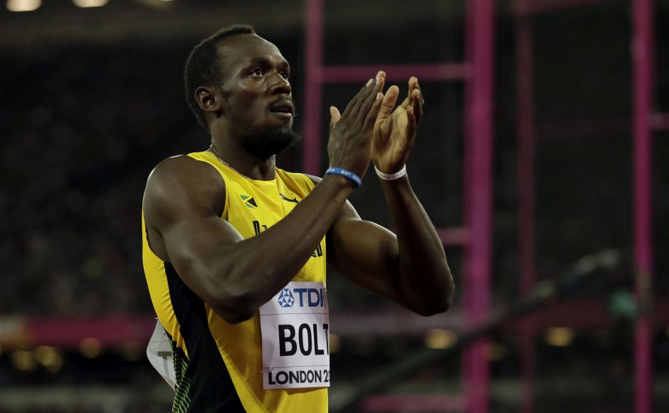 Usain Bolt stuck to tradition in his farewell championships, revving up the crowd at the Olympic Stadium with his aura before his victory in the first-round heat of the 100 meters. AP