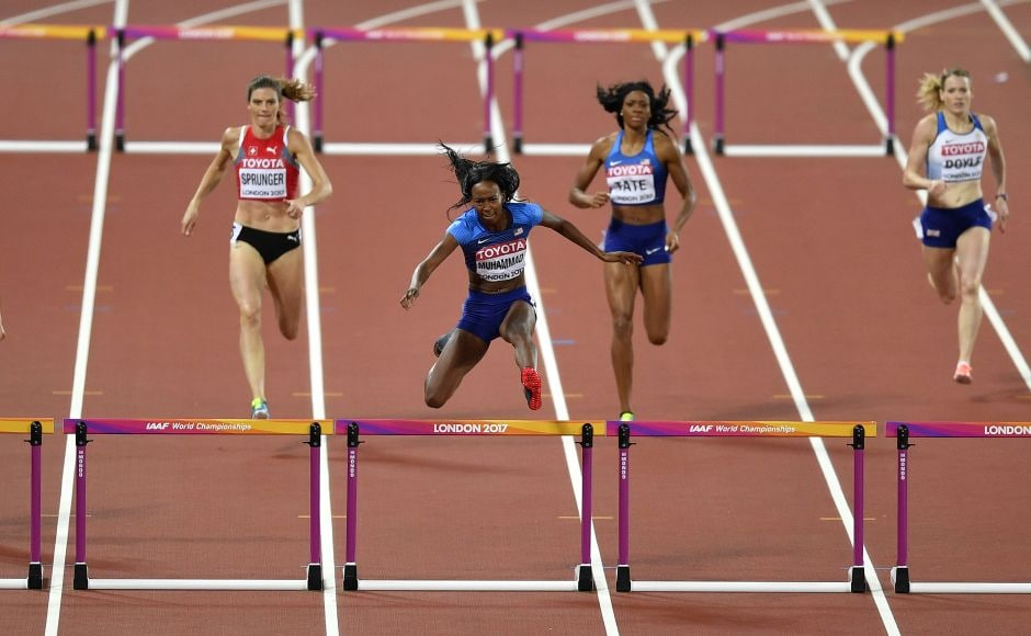Dalilah Muhammad (centre) jumps the final hurdle on her way to a silver medal in the women's 400 metre hurdles final. AP