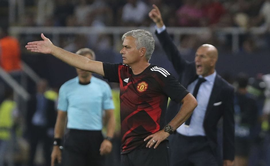 Manchester United manager Jose Mourinho and Real Madrid manager Zinedine Zidane give instructions to their players during the match. It was Zidane's second consecutive Super Cup title. For United coach Jose Mourinho, it was a third failed attempt to add the trophy to his collection. AP