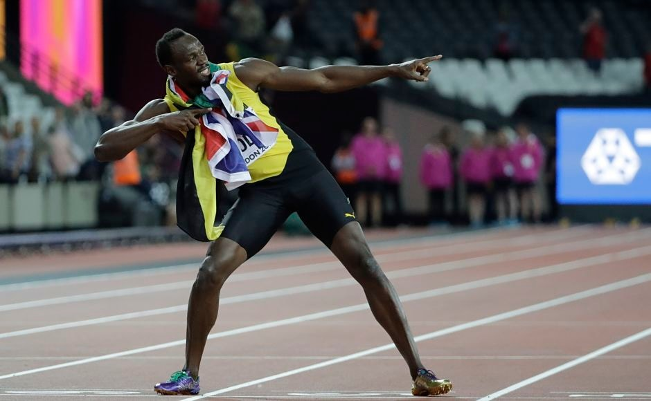 Jamaica's Usain Bolt performs his trademark pose on the finish line after placing third in the men's 100m final during the World Athletics Championships in London. AP