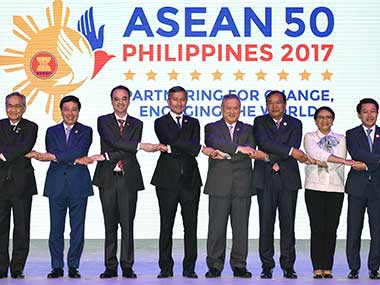 """ASEAN Foreign Ministers link hands """"The ASEAN Way"""" at the opening ceremony of the 50th ASEAN Foreign Ministers Meeting at the Philippine International Convention Center on Saturday. AP"""