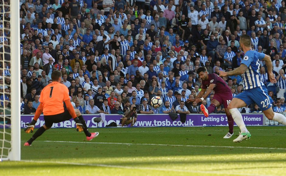 Manchester City's Sergio Aguero scores their first goal against Brighton & Hove Albion. Pep Gaurdiola's side cruised to a 2-0 win in their Premier League opener. Reuters