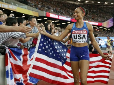 United States' gold medal winner Allyson Felix celebrates with fans after the women's 4x400-meter relay final during the World Athletics Championships in London. AP