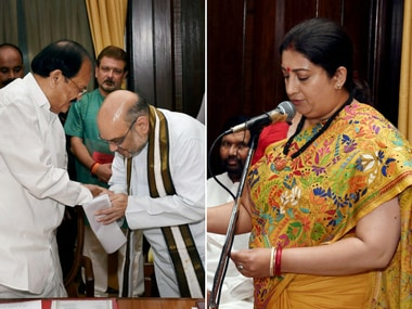 Union minister Smriti Irani and BJP chief Amit Shah take oath of office as Rajya Sabha MPs at Parliament House in New Delhi on Friday. PTI