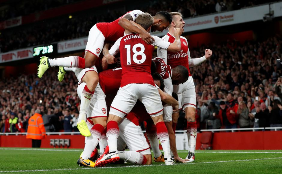 Arsenal players celebrate after they fought back twice to beat Leicester City 4-3 in a thriller on the opening night of the Premier League 2017/18 season. Reuters