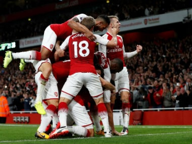 Olivier Giroud celebrates scoring Arsenal's fourth goal with team mates. Reuters