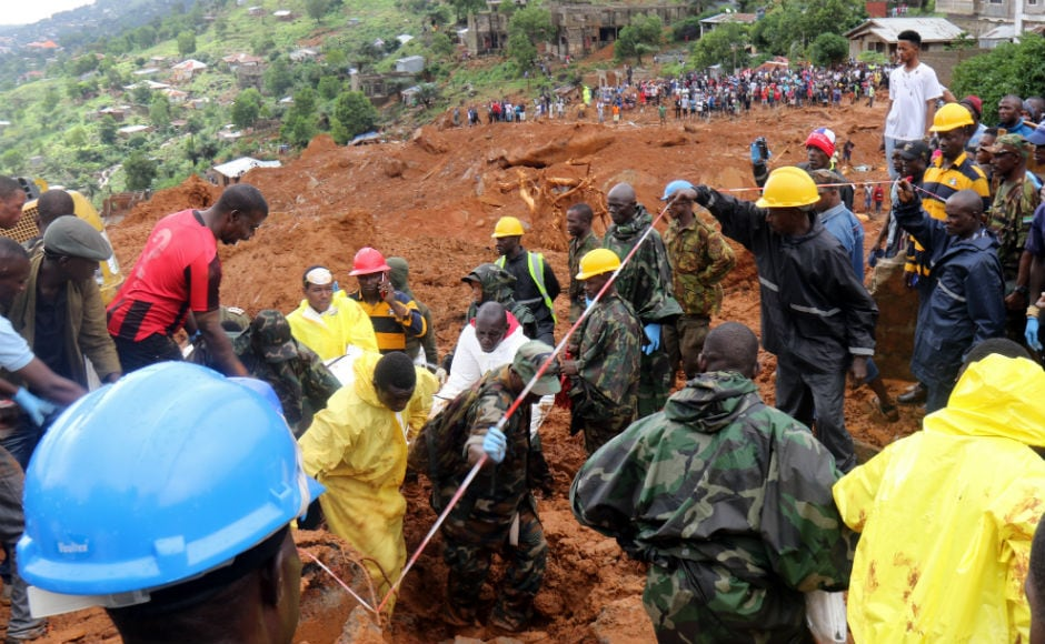 The mudslide which occurred after three days of torrential rain overran several houses killing residents, many of whom were trapped inside. AP