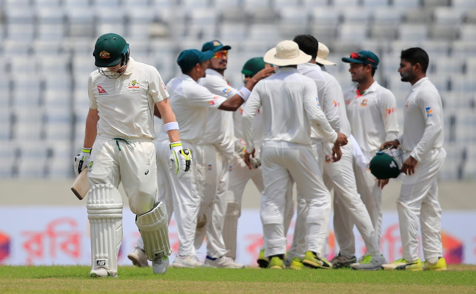 Australia's captain Steve Smith walked back to the pavilion after he was dismissed caught behind by Bangladesh's Shakib Al Hasan. AP