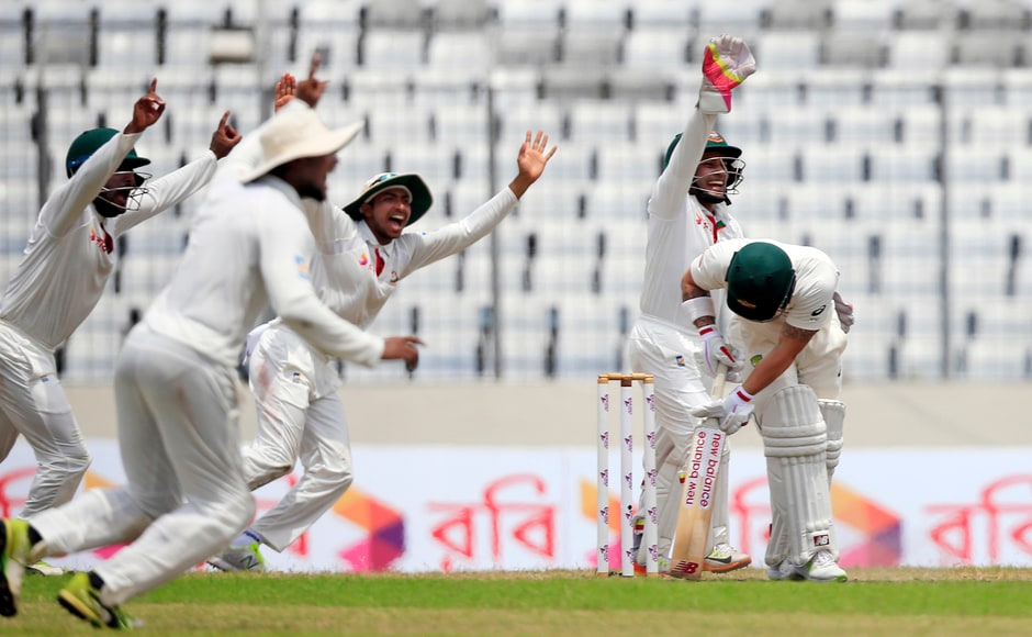 Bangladeshattacked with players surrounding the bat as Australia's wicketkeeper Matthew Wade became another of Shakib's victim. AP