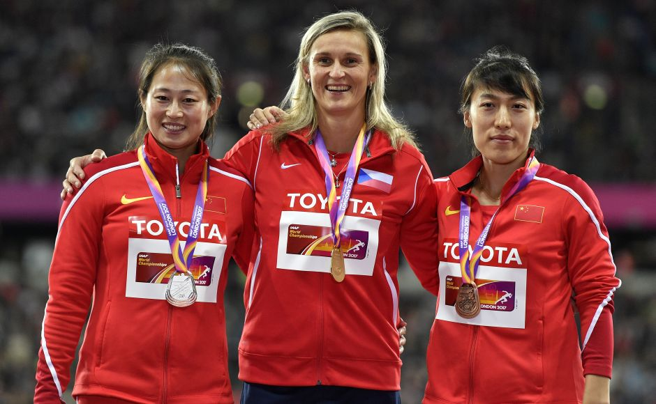 Women's javelin gold medalist Barbora Spotakova (Centre) stands with silver medalist China's Li Lingwei (L) and bronze medalist China's Lyu Huihui on the podium following the medal ceremony.