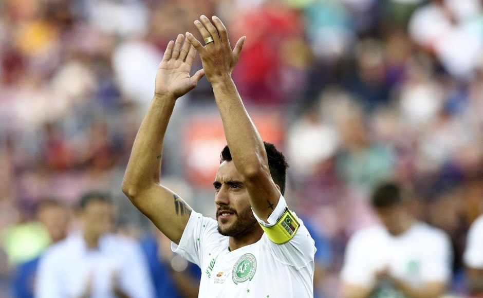 Alan Ruschel wore the captain's armband for Chapecoense during the 36 minutes he played before being substituted. He received a standing ovation from the crowd, which he returned by applauding with his hands held high as he slowly walked to the dugout. AP