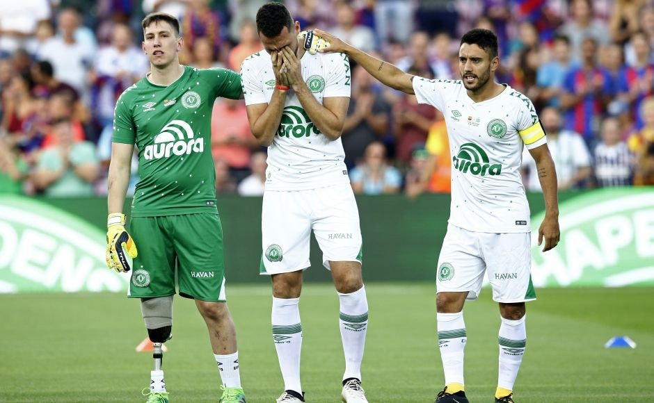 """Along with Alan Ruschel (R), Jackson Follmann (L) and Helio Zampier Neto (centre), were the only other Chapecoense players to survive the crash. The crowd saluted the Chapecoense players as their names were called before the match. Barcelona midfielder Andres Iniesta welcomed the visitors, telling the stadium that """"today is a very special night."""" AP"""