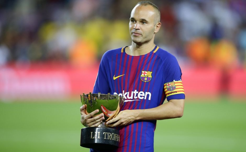 Barcelona's Andres Iniesta holds the Joan Gamper trophy afterthe match.In an emotional night at Camp Nou, the match was more about overcoming the terrible tragedy that had shaken Chapecoense than a warm-up game for the Catalan club. AP