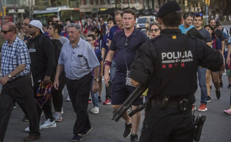 Security was stepped up for the match after the attack and police put up scores of roadblocks across northeast Spain on Sunday in hopes of capturing a fugitive suspect at large following the vehicle attack. AP