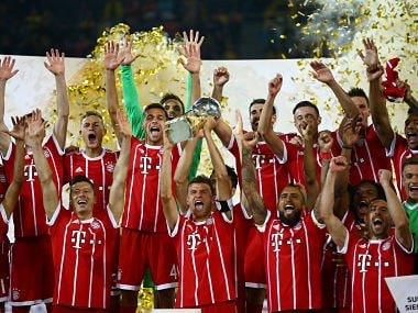 Bayern Munich's Thomas Muller celebrates with the trophy after winning the German Supercup Final. Reuters