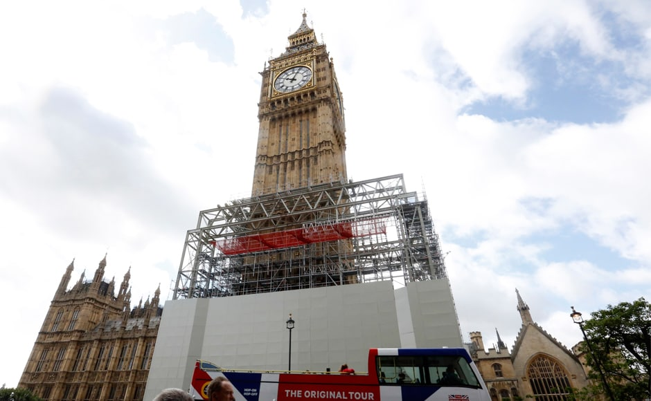 The Elizabeth Tower, as it is officially known, is said to be the most photographed building in the UK. In this 3 August, 2017 file photo, scaffolding is erected around the Elizabeth Tower, which includes the landmark Big Ben clock, as part of ongoing conservation efforts at the Palace of Westminster in London. AP