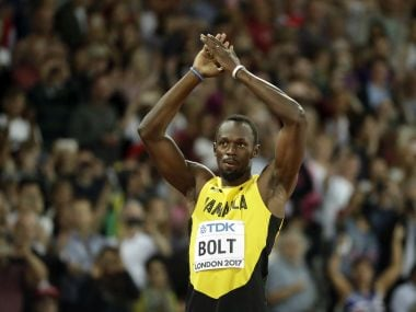 Jamaica's Usain Bolt greets his fans before a men's 100m heat during the World Athletics Championships in London Friday, Aug. 4, 2017. (AP Photo/Matt Dunham)