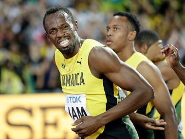 Jamaica's Usain Bolt grimaces after injuring himself during the men's 4x100m final. AP