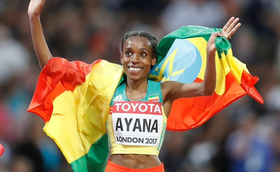 Ethiopia's Almaz Ayana celebrates during a victory lap after winning the Women's 10,000m final. AP