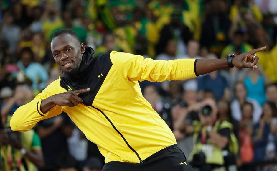 Jamaica's Usain Bolt makes his trademark gesture during a lap of honor at the end of the World Athletics Championships in London. AP
