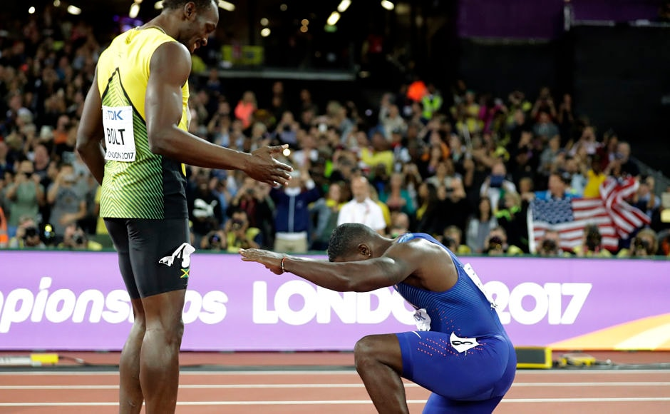 Gold medal winner United States' Justin Gatlin knees in front of Jamaica's Usain Bolt, who won bronze, after the men's 100m final. AP