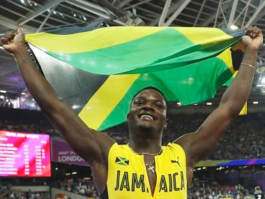 Jamaica's Omar Mcleod celebrates after winning the gold medal in the men's 110-meter hurdles final during the World Athletics Championships in London Monday, Aug. 7, 2017. (AP Photo/Matt Dunham)