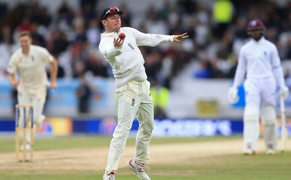 Substitute fielder Mason Crane celebrates after taking a stunner to send Roston Chase back to the hut for 30. AP
