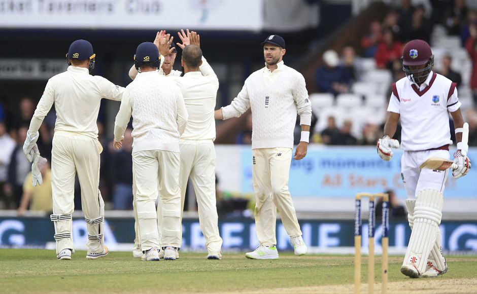 England celebrate after dismissing Kraigg Brathwaite and ending a 144-run stand between him and Shai Hope. AP