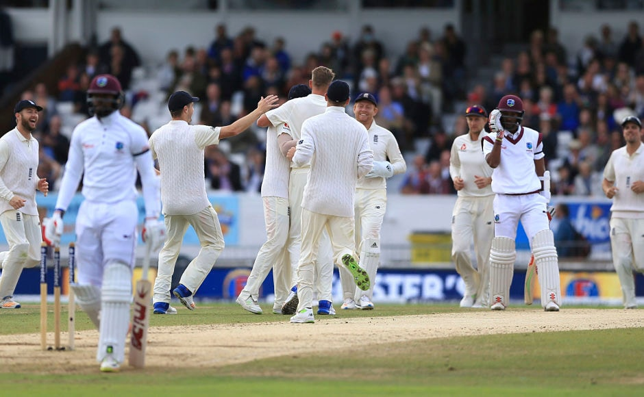 England's Stuart Broad celebrates after his run out of Windies' Kyle Hope during day five of the second Test. AP