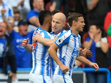 Huddersfield Town's Aaron Mooy celebrates with teammates after scoring against Newcastle United. AP