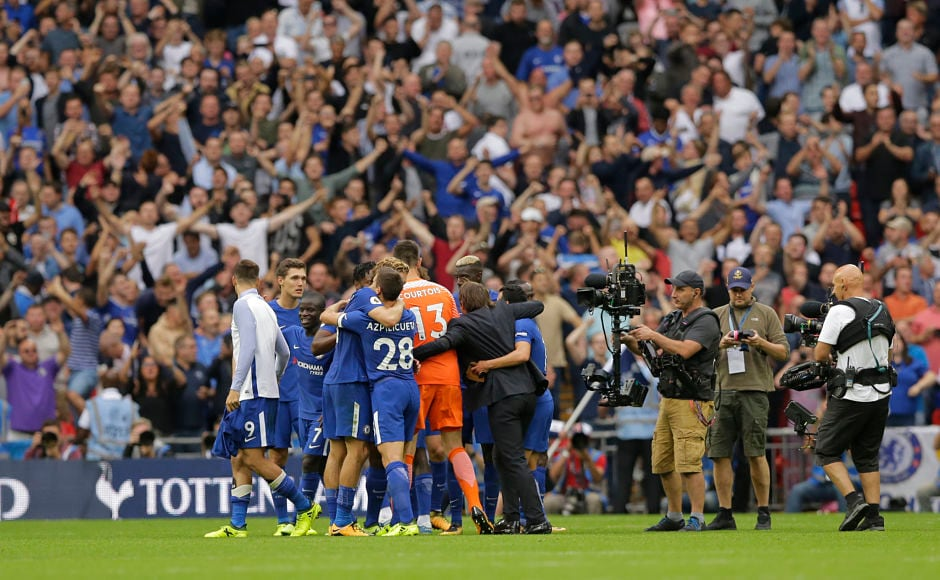 Chelsea team and manager Antonio Conte celebrate in front of their fans after securing their first win of the 2017/18 campaign. It was Tottenham's first match at their new home Wembley Stadium. AP