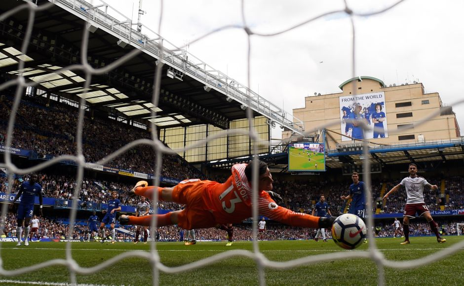 Chelsea endured a shocking start to the defence of their Premier League title on Saturday, losing 3-2 at home to Burnley. Sam Vokes scored two goals to send Burnley into the halftime break a worthy if unexpected 3-0 up. Voakes pictured here scoring the first goal. Reuters