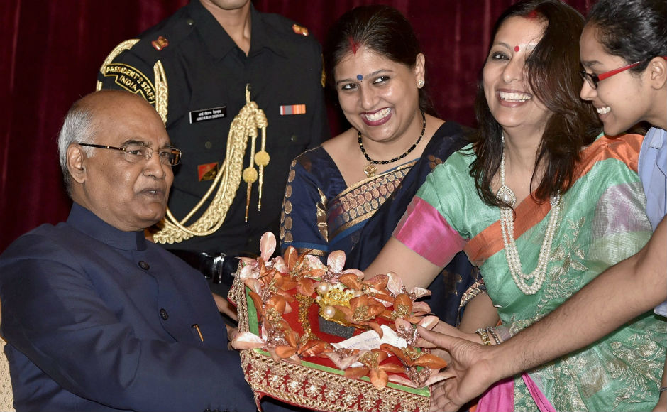 A delegation of 116 women and 27 men, representing the Koli Samaj, tied the traditional rakhi on the hands of the president. PTI