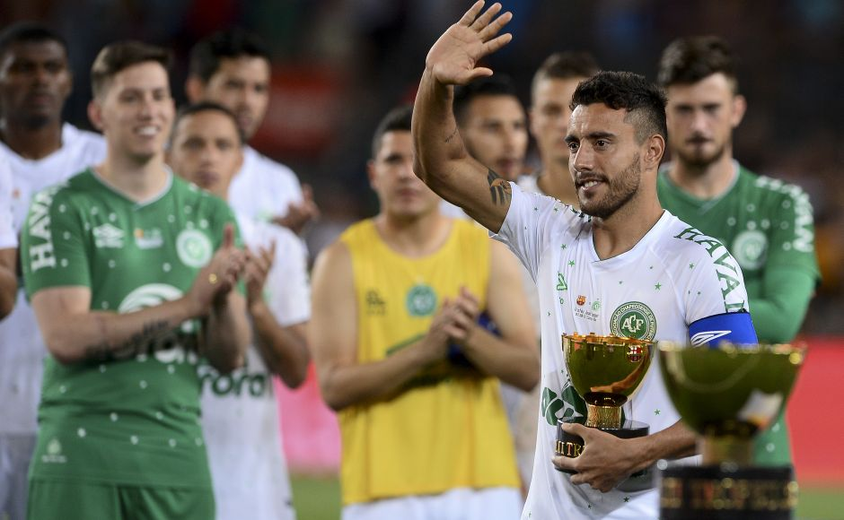 Chapecoense's defender Alan Ruschel holds the second place trophy. Eight months after surviving the plane crash that killed most of his Chapecoense teammates, Ruschel returned to the football field. AFP