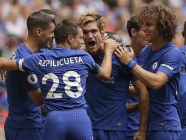 Chelsea's Marcos Alonso, centre, celebrates with teammate Chelsea's Victor Moses after scoring the opening goal of the game during their English Premier League soccer match between Tottenham Hotspur and Chelsea at Wembley stadium in London, Sunday Aug. 20, 2017. (AP Photo/Alastair Grant)